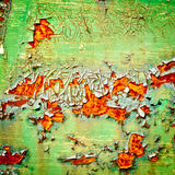 Peeling paint on rusty metal background Stock Photos