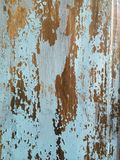 Peeling Paint Texture II. Color photo of blue paint wearing off of a dark wood surface stock photo