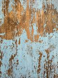 Peeling Paint Texture II. Color photo of blue paint wearing off of a dark wood surface Stock Image