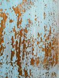 Peeling Paint Texture II. Color photo of blue paint wearing off of a dark wood surface royalty free stock photography