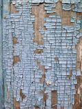 Peeling paint on wall seamless texture. Pattern of rustic blue grunge material. Royalty Free Stock Photography