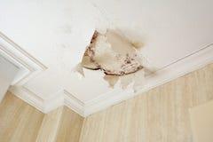 Peeling paint wall of water leak in plaster ceiling. Of bathroom royalty free stock image