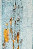 Peeling paint on weathered wood Royalty Free Stock Photo
