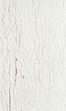Peeling paint on a white wooden wall. Stock Photos