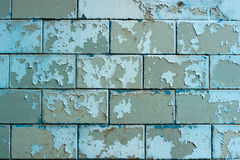 Peeling painted blue tiles on the plinth. Of house Stock Photography