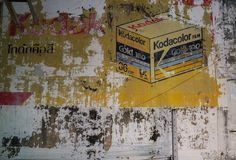 Peeling painted sign of of old Kodacolor film sign on citty stre Royalty Free Stock Photography