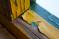 Peeling paintwork. Detail of peeling paintwork on  a wooden window frame Royalty Free Stock Image