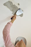 Peeling with a Plaster Spatula Stock Photography