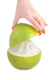 Peeling a pomelo Stock Photos