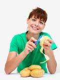 Peeling potato royalty free stock photo