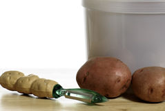 Peeling Potatoes Royalty Free Stock Images