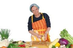 Peeling potatoes Royalty Free Stock Image