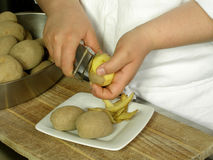 Peeling potatoes Royalty Free Stock Image