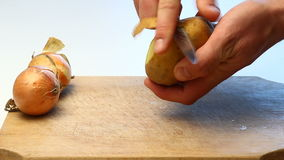 Peeling potatoes video Stock Photos