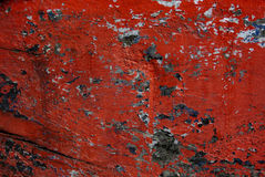 Peeling red paint. From hull of boat stock image