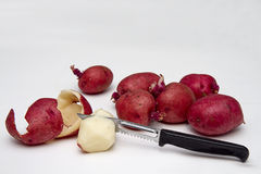 Peeling Red Potatoes Royalty Free Stock Image