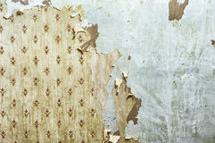 Peeling wallpaper on drywall. Wallpaper peeling off a plasterboard wall (drywall) during interior decoration. This image could also be used to illustrate disuse Stock Image