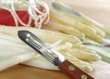 Peeling White Asparagus Stock Images