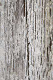 Peeling White Paint Background Texture. Peeling paint on wood, white and faded, as a background texture or for interior design stock photography