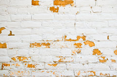 Peeling white painted brick Stock Photo