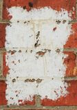 Peeling white post background on brick wall with copy space royalty free stock photos