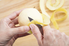 Peeling yellow apple Stock Photos