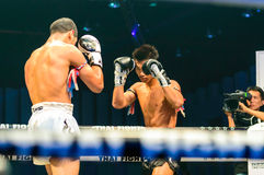 Peemai Jitmuangon of Thailand and Youssef Boughanem of Belgium in Thai Fight Extreme 2013. Royalty Free Stock Photo