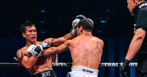 Peemai Jitmuangon of Thailand and Youssef Boughanem of Belgium in Thai Fight Extreme 2013. Stock Photo