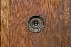 Peep hole. Old door peep hole in wooden door Royalty Free Stock Image