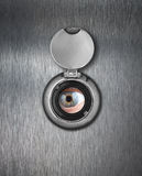 Peep hole closeup with human eye Stock Images