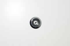 Peep hole. On a white door Royalty Free Stock Image