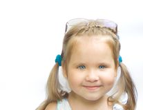 Peep-holes are already healthy!. Girl spectacled on a white background with a smile Stock Photography