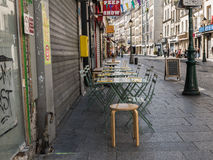 Peep show sign and cafe tables on the rue Saint Denis, Paris Royalty Free Stock Images