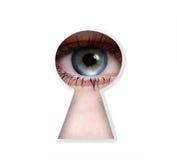 Peeper eye. To the keyhole isolated on white background Royalty Free Stock Photo
