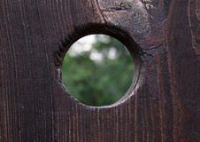 Peephole. In a wooden door Royalty Free Stock Photography
