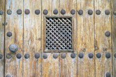 Peephole. Detail of a peephole in an old  wood door Royalty Free Stock Image
