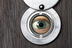 Peephole with eye horizontally Royalty Free Stock Image