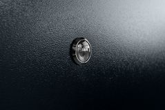 Peephole at black white door with black handle Stock Photos