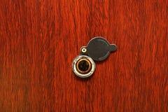 Peephole on wooden door Royalty Free Stock Image