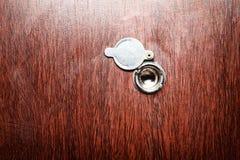 Peephole on wooden door Royalty Free Stock Photography
