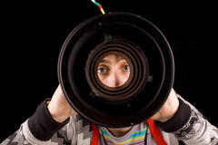 Peeping through a cylinder Stock Photo