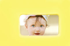 Peeping girl Royalty Free Stock Photo