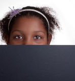 Peeping over black sign Stock Image