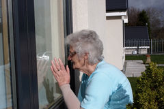 Peeping pensioner Stock Image