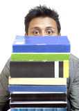 Peeping Through the Stack of Books Royalty Free Stock Photos