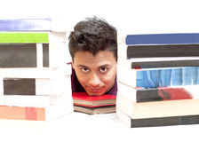 Peeping Through the Stack of Books Royalty Free Stock Photo
