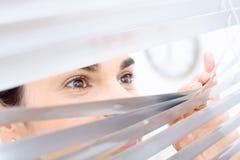 peeping though window woman στοκ φωτογραφίες