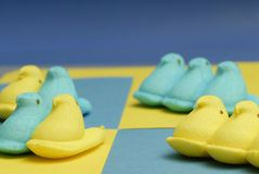 Peeps. Sweet peeps over yellow and blue Stock Images
