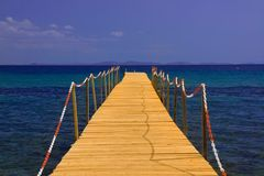 Pier on blue sea with blue sky Royalty Free Stock Photography