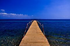 Pier on blue sea with blue sky Royalty Free Stock Photos